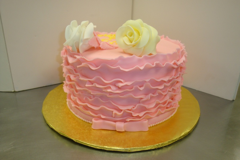 fondant covered ruffle cake with roses $6/serving