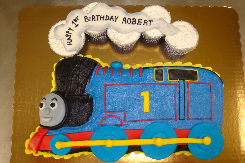 15 serving thomas cake $85 plus smoke cupcakes $1/each